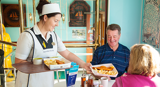 Smiles all-round as one of Anstruther Fish Bar and Restaurant's friendly team of staff serve up more delicious Scottish seafood.